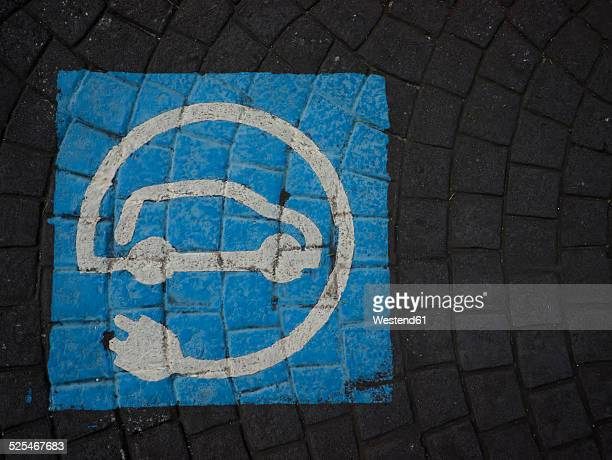 Spain, pavement with pictogram for parking lot of electric cars