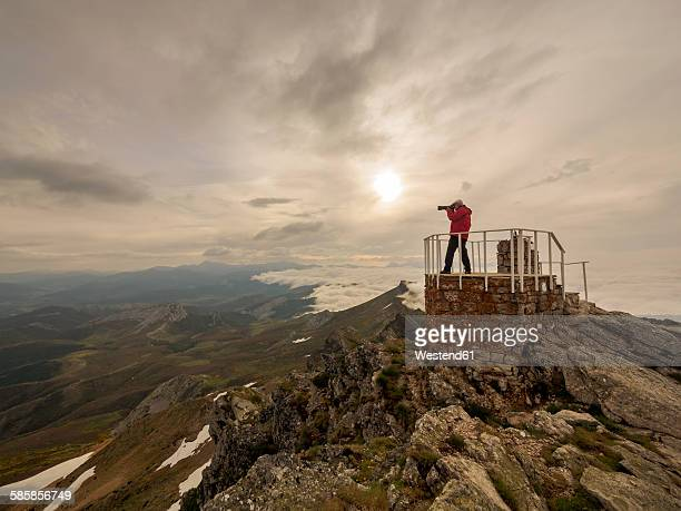 spain, pico tres mares, senior man photographing at observation point - três pessoas stock pictures, royalty-free photos & images