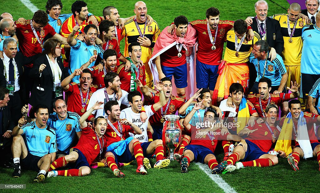 Spain players and coaching staff celebrate with the trophy following victory in the UEFA EURO 2012 final match between Spain and Italy at the Olympic Stadium on July 1, 2012 in Kiev, Ukraine.