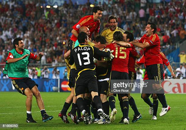 Spain players celebrate after Cesc Fabregas of Spain shoots and scores the winning penalty in the shoot out during the UEFA EURO 2008 Quarter Final...