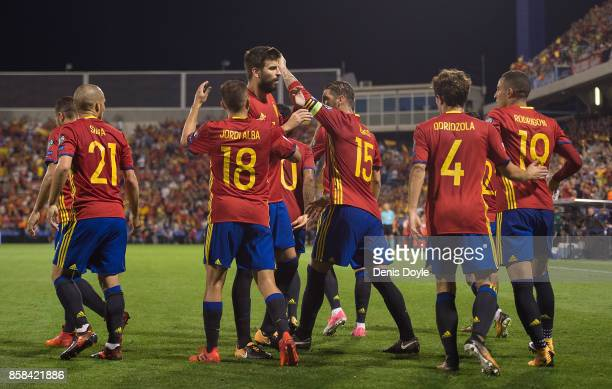Spain players celebrate after scoring the opening goal during the FIFA 2018 World Cup Qualifier between Spain and Albania at Estadio Jose Rico Perez...