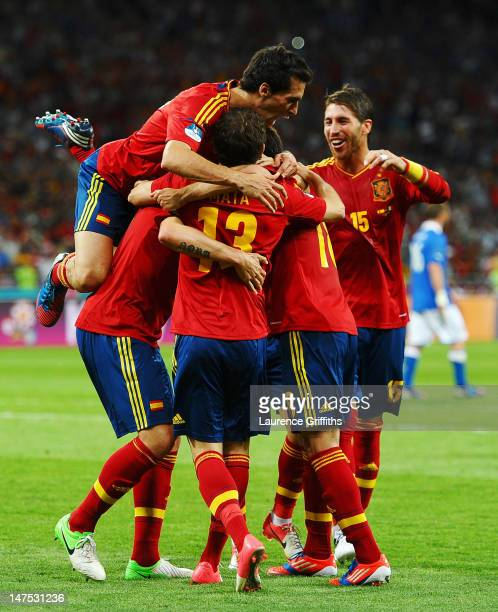 Spain players celebrate after team-mate Juan Mata scored their fourth goal during the UEFA EURO 2012 final match between Spain and Italy at the...