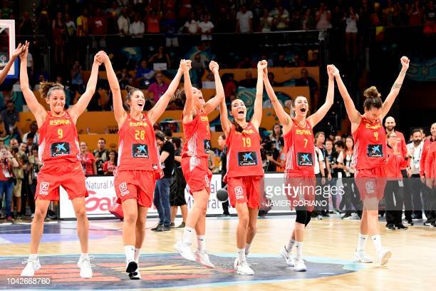 Spain players celebrate at the end of the FIBA 2018 Women's Basketball World Cup quarter final match between Canada and Spain at the Santiago Martin...