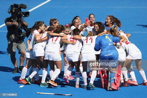 Spain players celebrate their victory and their bronze medal finish by holding aloft a pineapple during the Third Place Play Off game between...