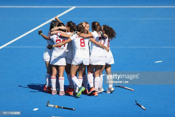 Spain players celebrate their victory and their bronze medal finish during the Third Place Play Off game between Australia and Spain of the FIH...