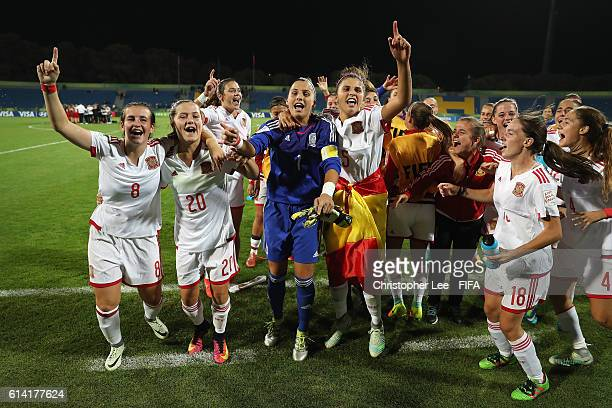 Spain players celebrate their victory during the FIFA U17 Women's World Cup Jordan 2016 Quarter Final match between Germany and Spain at Amman...