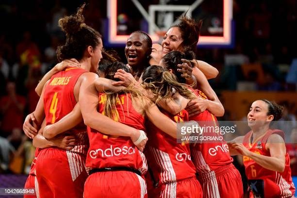 TOPSHOT Spain players celebrate their win at the end of the FIBA 2018 Women's Basketball World Cup quarter final match between Canada and Spain at...