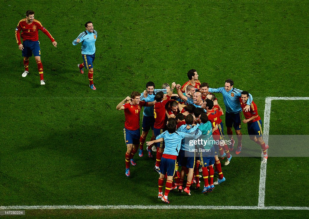 Spain players celebrate victory during the UEFA EURO 2012 semi final match between Portugal and Spain at Donbass Arena on June 27, 2012 in Donetsk, Ukraine.
