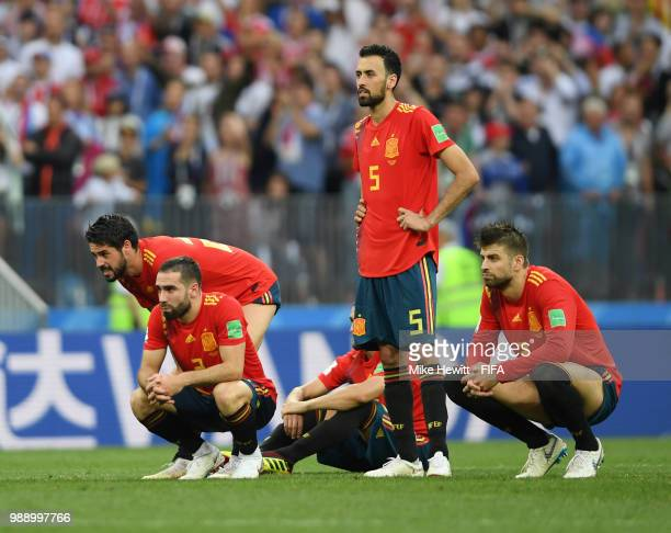 Spain players look dejected during penalty shoot out following the 2018 FIFA World Cup Russia Round of 16 match between Spain and Russia at Luzhniki...