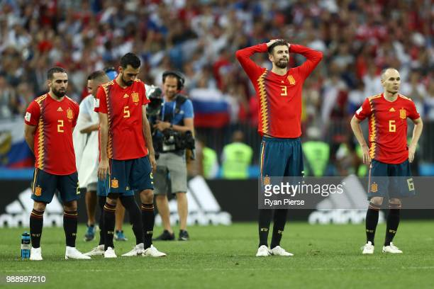 Spain players look dejected during the 2018 FIFA World Cup Russia Round of 16 match between Spain and Russia at Luzhniki Stadium on July 1, 2018 in...