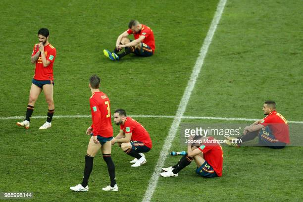 Spain players look dejected following their sides defeat in the 2018 FIFA World Cup Russia Round of 16 match between Spain and Russia at Luzhniki...