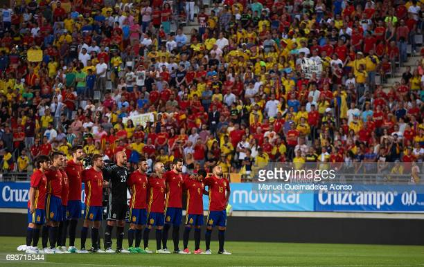 Spain players observe a minute of silence for the victim of the London Bridge Ignacio Echeverria prior to the international friendly match between...