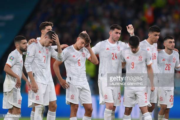 Spain players react in the penalty shootout during the UEFA EURO 2020 semi-final football match between Italy and Spain at Wembley Stadium in London...
