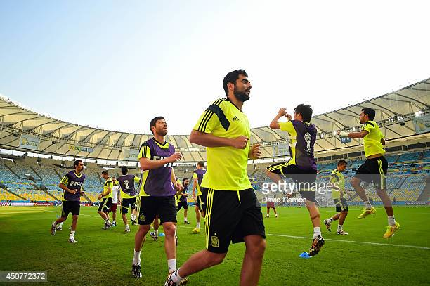 Spain players warm up during a Spain training session ahead of their 2014 FIFA World Cup Group B match against Chile at Maracana on June 17, 2014 in...