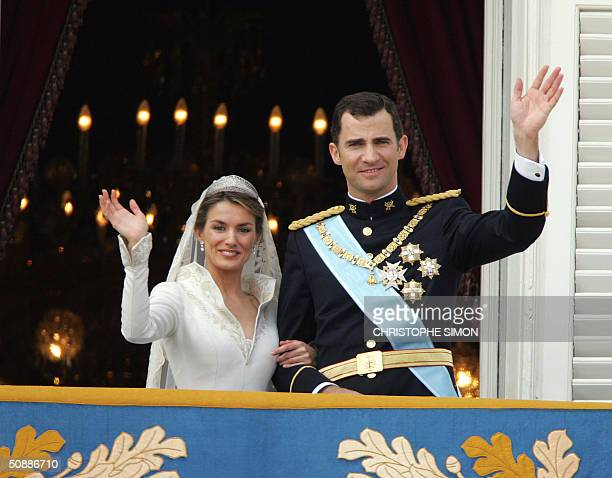 Princess of Asturias Letizia Ortiz and her husband Spanish Crown Prince Felipe of Bourbon wave to the crowd after their their wedding ceremony 22 May...