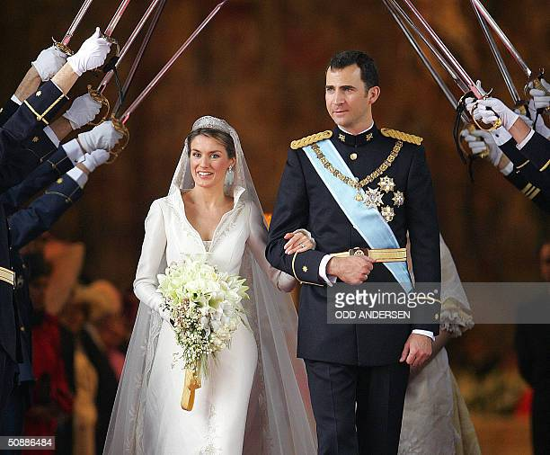 Princess of Asturias Letizia Ortiz and Spanish Crown Felipe of Bourbon leave Madrid's Almudena Cathedral at the end of their wedding ceremony 22 May...