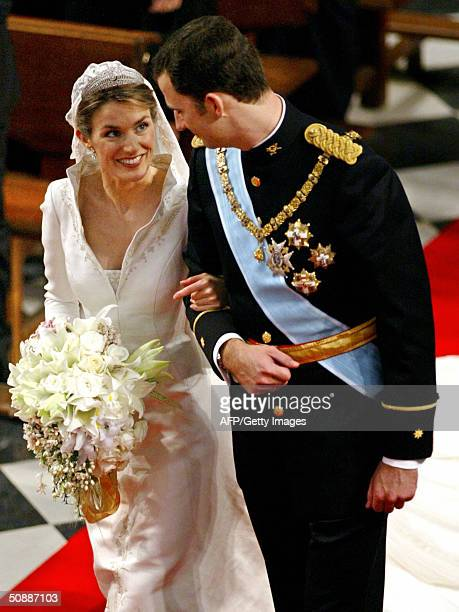 Princess of Asturias Letizia Ortiz looks at her husband Spanish Crown Prince Felipe as she gets ready to place her bridal bouquet at Madrid's...