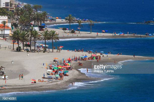 spain, province of granada. castell de ferro. people on the beach seen from above. - málaga málaga province ストックフォトと画像
