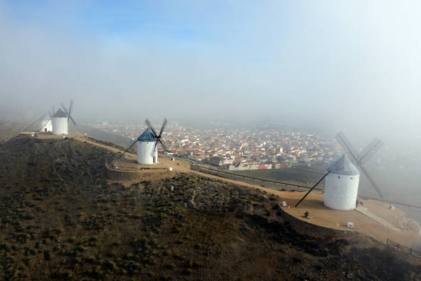 Spain, Province of Toledo, Consuegra, Aerial view of historical windmills with town in background