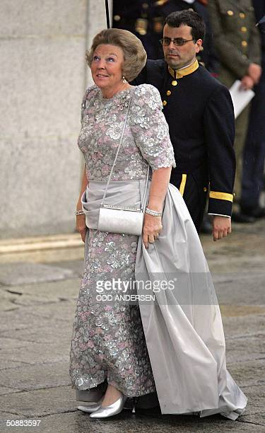 Queen Beatrix of the Netherllands looks at the sky as she arrives to attend an official diner at the Pardo Palace in Madrid 21 May 2004 on the eve of...
