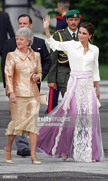 Queen Rania of Jordan waves to the crowd as she arrives with Princess Muna Al Hussein of Jordan at Madrid's Almudena Cathedral to attend Spanish...