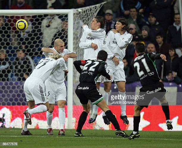 Racing Santander's Ayoze shoots and scores from a free kick past Real Madrid's Garcia Sergio Ramos French Zinedine Zidane and Briton David Beckham...