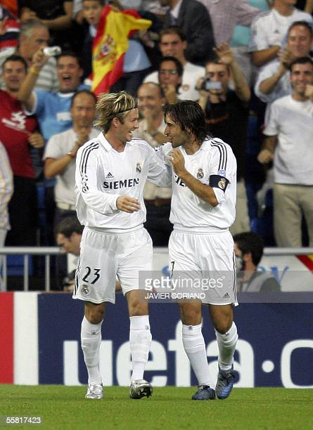 Real Madrid Briton David Beckham celebrates with his teammate Raul after Raul scored to make it 10 against Olympiakos during their Champions League...