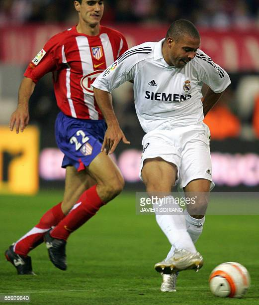 Real Madrid's Brazilian Ronaldo shoots to score his second goal against Atletico de Madrid during their Spanish league football match at the Vicente...