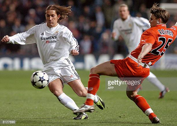 Real Madrid's Spanish defender Michel Salgado and Monaco's French midfielder Jerome Rothen run for the ball during their Champions League...