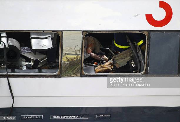 rescue workers try to free bodies from the train after it exploded at the Atocha train station in Madrid 11 March 2004 At least 173 people were...