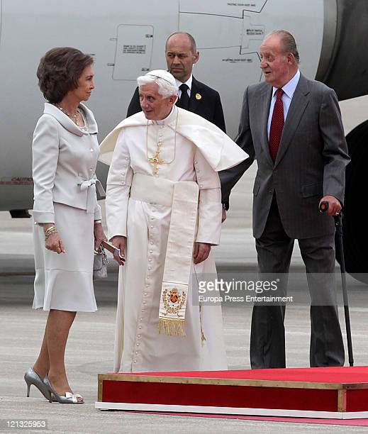 Spain 's King Juan Carlos and Queen Sofia welcome Pope Benedict XVI upon his arrival at Madrid's Barajas airport on August 18 2011 Initiated by Pope...