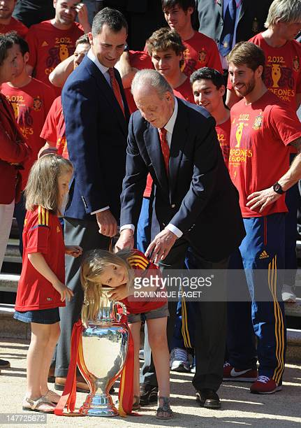 Spain' s Prince Felipe and Princesses Leonor and Sofia pose with the EURO 2012 trophy at the Zarzuela palace in Madrid on July 2 a day after the...