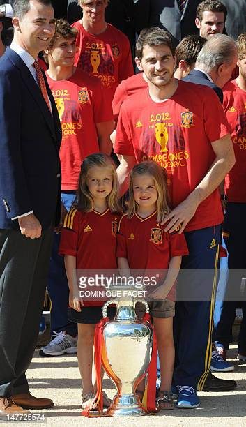 Spain' s Prince Felipe Spain's goalkeeper and captain Iker Casillas and Princesses Leonor and Sofia pose with the EURO 2012 trophy at the Zarzuela...