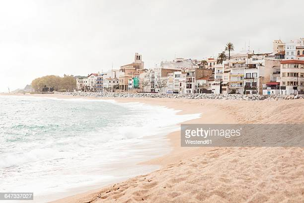 Spain, Sant Pol de Mar, view to empty beach