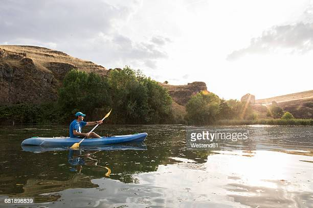 spain, segovia, man in a canoe in las hoces del rio duraton - kayak stock pictures, royalty-free photos & images