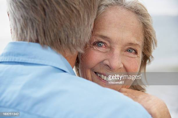 Spain, Senior couple embracing each other, smiling