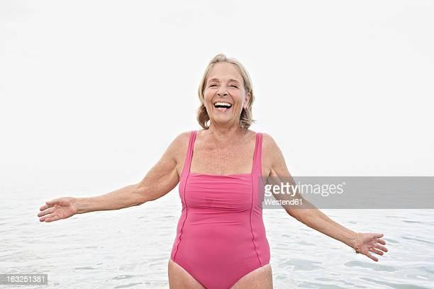 Spain, Senior woman on beach