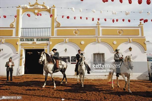 Spain, Seville April Fair, men on horseback