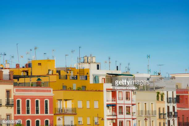 spain, seville, triana, colorful residential buildings - seville stock pictures, royalty-free photos & images