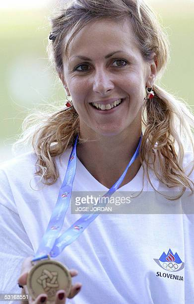 Slovenian Alenka Bikar shows her gold medal after winning women's 200m final race of the XV Mediterranean Games 29 June 2005 in Almeria southern...