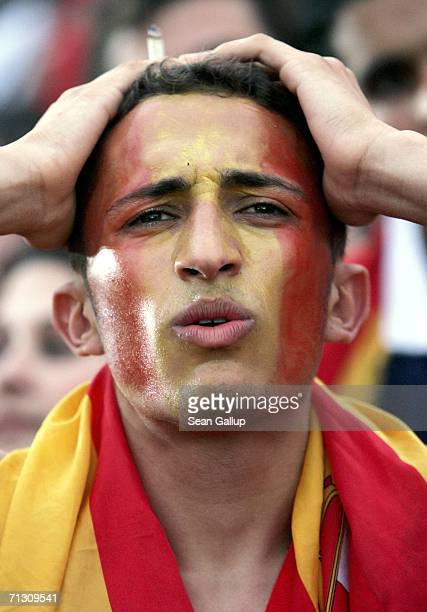 Spain soccer fans react to a lost goal against France in their FIFA World Cup 2006 Round of 16 match at an open-air public viewing area June 27, 2006...