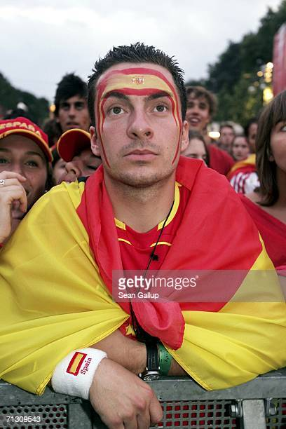 Spain soccer fans react to play during their FIFA World Cup 2006 Round of 16 match against France at an open-air public viewing area June 27, 2006 in...