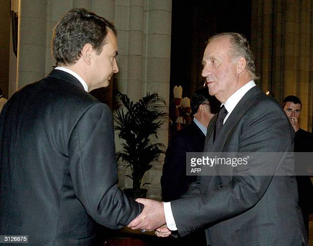 Spain's King Juan Carlos shakes hands with Prime Ministerelect Jose Luis Rodriguez Zapatero prior to the memorial mass held for the victims of the 11...