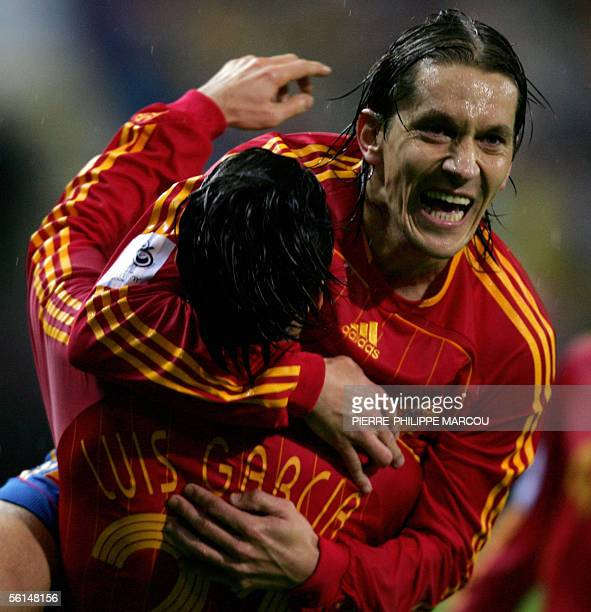 Spain's Luis Garcia celebrates with Michel Salgado after scoring his second goal against Slovakia during their World Cup 2006 qualifying first leg...