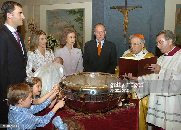 Spains Prince Felipe Princess Letizia with daughter Leonor Queen Sofia and King Juan Carlos take part in Leonor's baptism presided over by Cardinal...