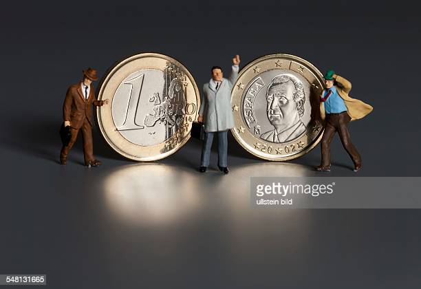 Spain Spanish 1 Euro coin and businessmen