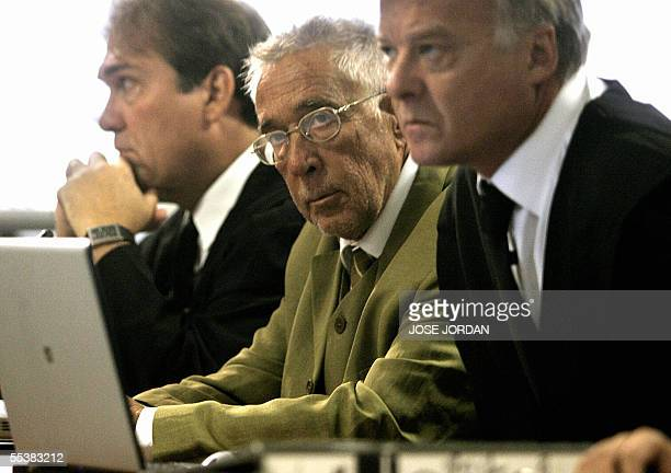 Spanish anaethetist Juan Maeso is seen flanked by his lawyers in court in Valencia where he is charged with infecting over 276 patients with the...