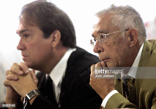 Spanish anaethetist Juan Maeso is seen with his lawyer Francisco Davo in court in Valencia where he is charged with infecting over 276 patients with...