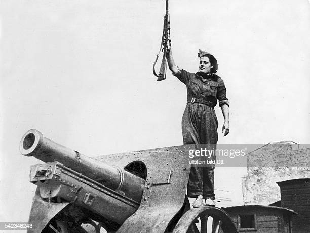 Spain Spanish Civil War Member of a women's battalion with gun standing on a cannon no place given midAugust 1936 Vintage property of ullstein bild