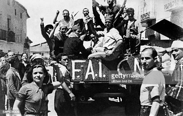 Spain Spanish Civil War members of the Popular Front raising their fists on a truck with the abbreviations of the FAI and CNT 1938 Photographer...